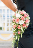Hand holding a bouquet royalty free stock photos