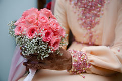 Hand Holding Bouquet of Flower. A bride's hand holding a bouquet of flower on wedding day Stock Images