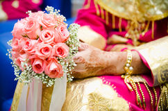 Hand Holding Bouquet of Flower. A bride's hand holding a bouquet of flower on wedding day Royalty Free Stock Photography