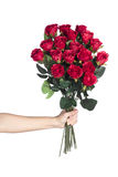 Hand holding bouquet of red roses Stock Photos