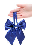 Hand holding bow tie for woman Royalty Free Stock Photos