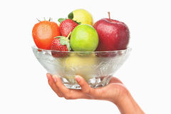 Hand holding bowl of fruits Royalty Free Stock Photography