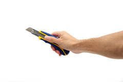 Hand holding a box cutter Royalty Free Stock Images