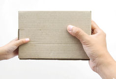 Hand holding a box on white background Royalty Free Stock Photography