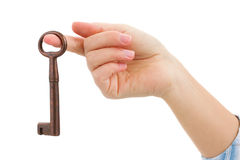 Hand holding brass key Stock Images