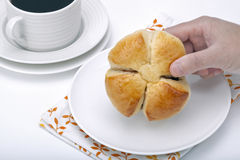 Hand holding a bread Royalty Free Stock Images