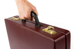 Hand holding a briefcase Royalty Free Stock Photo