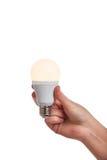 Hand holding bright led light bulb Royalty Free Stock Photography