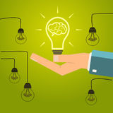 Hand holding a bright light bulb. Concept of inspiration, ideas. Royalty Free Stock Photography