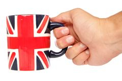 Hand holding british mug Royalty Free Stock Image