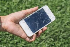 Hand holding broken mobile smartphone. Hands holding broken mobile smartphone , Cracked smartphone in hand holding. sad concept. damage concept. technology royalty free stock photo