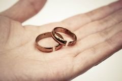 Hand holding broken rings. / Divorce cond ending relationship concept Royalty Free Stock Photos