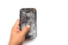 Hand holding broken smart phone isolated on white. Background stock photo