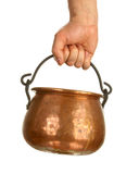 Hand holding bronze pot Royalty Free Stock Photography