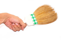 Hand holding broom isolated on white Stock Images