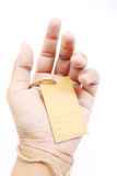 Hand holding brown empty paper tag Stock Image