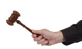Hand holding a Brown gavel on a white background Stock Image