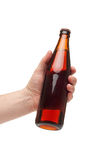 Hand holding a brown transparent bottle. Isolated on white Stock Images