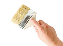 Hand holding a brush Royalty Free Stock Photos