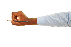 Hand holding a brush. Hand of black busines man holding a brush Stock Images