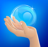 Hand holding bubble or glass ball Royalty Free Stock Photography