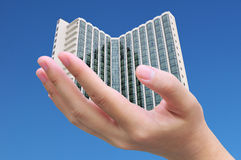Hand holding building Royalty Free Stock Photo