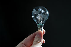 Hand holding a bulb isolated Royalty Free Stock Photo