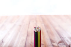 Hand holding a bunch of colored pencils Royalty Free Stock Images