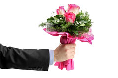 Hand holding bunch of roses Royalty Free Stock Photo