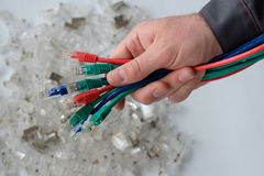 Hand holding. A bundle of colorful network cables Stock Image