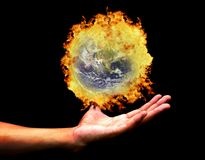 Hand holding burning earth(Earth view image from h Stock Photos