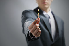 Hand holding a burning match Stock Photo
