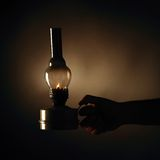 Hand holding burning old betty lamp Stock Images
