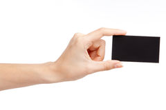 Hand holding a business card. Hand holding a black business card Royalty Free Stock Photo