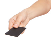 Hand holding a business card. Hand holding a black business card Royalty Free Stock Images