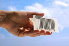 Hand holding business card with fake bar code Royalty Free Stock Image