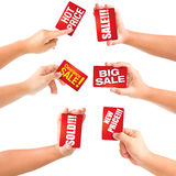 Hand holding business card sale with discounts. Royalty Free Stock Image
