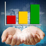 Hand holding business graph Stock Photography