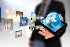 Hand holding business world. On tablet pc Royalty Free Stock Images
