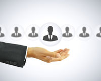 Hand holding businessman icon - HR concept Royalty Free Stock Images