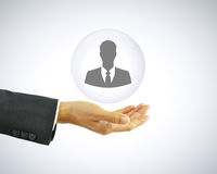 Hand holding businessman icon - HR concept Royalty Free Stock Photography