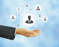 Hand holding businessman icon - HR concept Stock Image