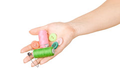 the hand holding the buttons, thread Stock Image