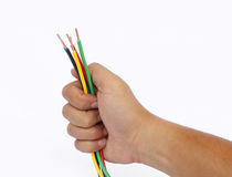 Hand holding cable. Hand holding multicolour electrical cable Stock Photo