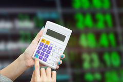 Hand holding calculator with blur background of  exchange rate b Royalty Free Stock Image