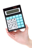 Hand holding calculator Stock Image