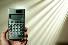 Hand holding a calculator Royalty Free Stock Photos