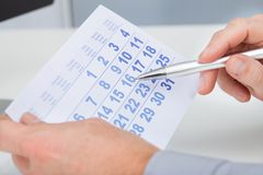 Hand holding calendar and pen Royalty Free Stock Photo