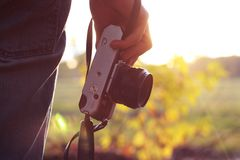 Hand holding camera Royalty Free Stock Photography