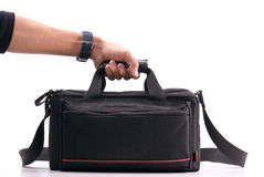 Hand Holding a Camera Bag Royalty Free Stock Images